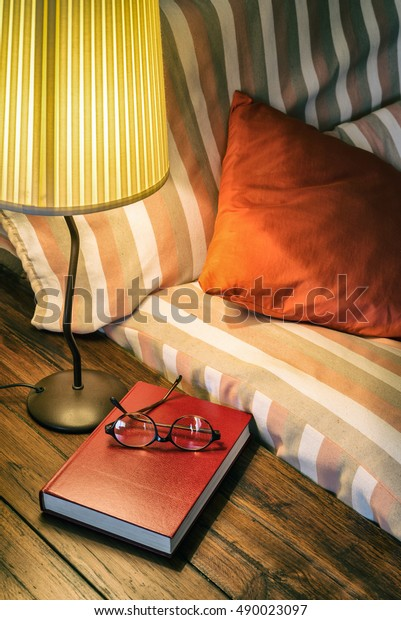 Fantastic Book Glasses On Table Beside Couch Stock Photo Edit Now Squirreltailoven Fun Painted Chair Ideas Images Squirreltailovenorg