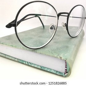 Book and glasses vintage old school
