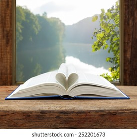 book heart shape page open window summer river view