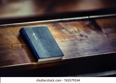Book Holy Bible on old wooden church table.