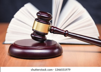 Book of laws. Legislation and law. Procedure for making laws. Concept of adoption of the law. Legal Code. Judge's gavel.