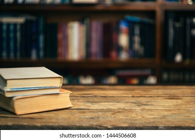 The book in the library (school, university, college) on the table. Reading, literature, learning and back to school concept. Copy space.