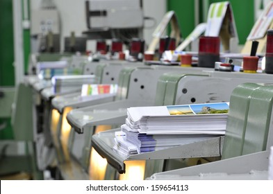 book, magazine production line into press plant house. Binding product.