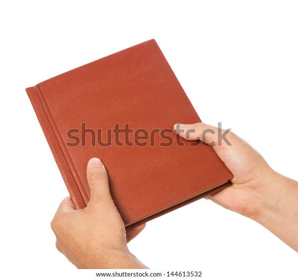 Book in a man's hands, isolated