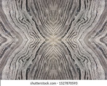 Book match marble natural stone name Black Forest marble with symmetrical pattern black brown grey color use for architecture and decoration design ,halloween background or other pattern,
