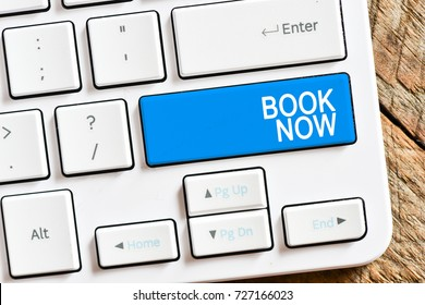 Book now / Computer white keyboard with book now.