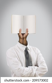 The book is on the place of the head, with the hands holding it. I used Adobe photoshop CS6 application.