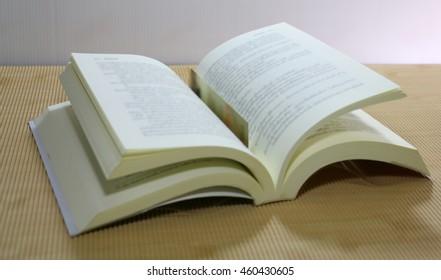 book on wooden desk