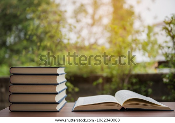 book on wooden table on bright background
