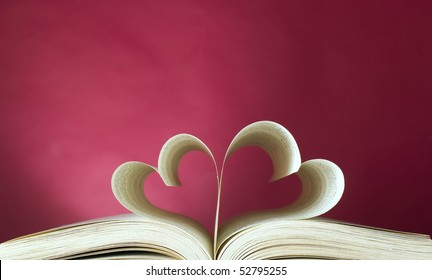 Book with opened pages and shape of heart