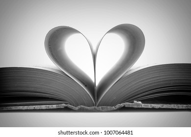 Book pages in the shape of a heart, black and white photography