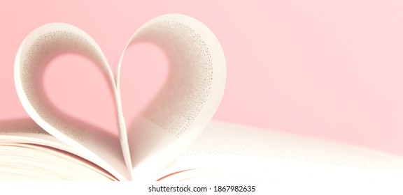 Book pages in shape of heart on pink background. Love, valentines or mother's day concept. Close up, copy space. - Shutterstock ID 1867982635