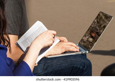 Book and  PC in the hands of people