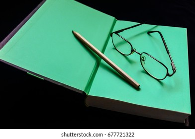 Book, pencil and glasses