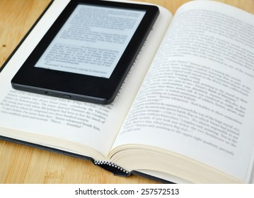 Book reader and an old fashioned book