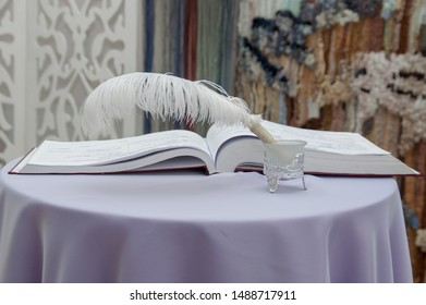 The book for registration of marriage. Beautiful book and pen for signature in the registry office