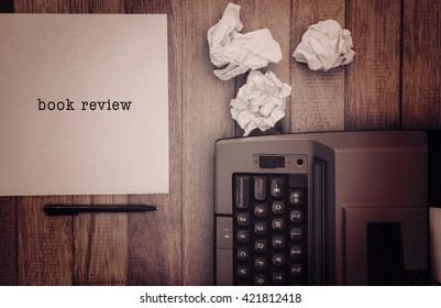 Book review message on a white background against view of an old typewriter and paper