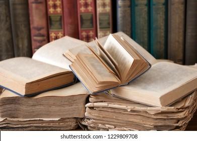 book shelf, books pile with antique books
