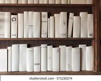 book shelf in the library, white cover book for fill your own texts