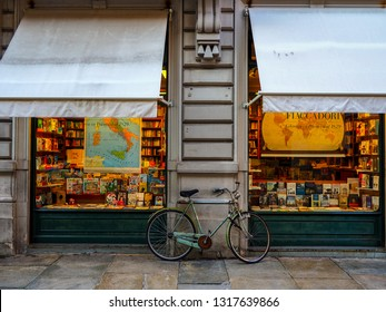 Book shop with a bycicle leaned on the wall at Parma, Italy 23 January 2019