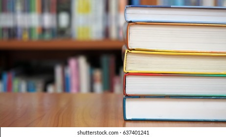 Book stack in the library room and blurred bookshelf, business and education background,  back to school concept