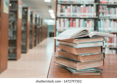 Book stack in the library room with copy space for business and education background.back to school concept