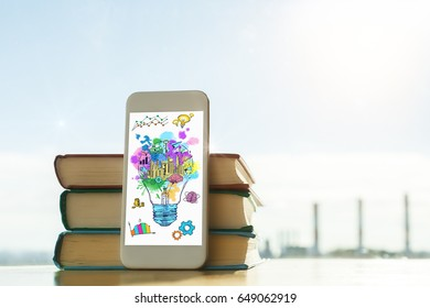 Book stack with smartphone and business sketch on blurry city background. Idea concept