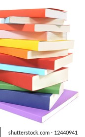 Book stack : untidy pile of colorful paperback books set isolated on white background.  Vertical format.