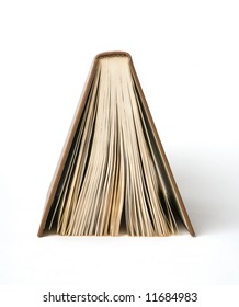 The book stands a back up on a white background