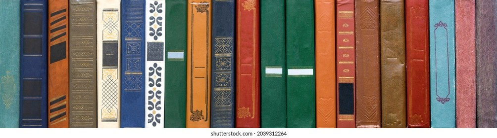 Book texture. Different vintage books in row. Literature, reading concept.
