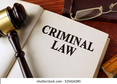 Book with title criminal law on a table.