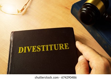 Book with title divestiture and gavel.