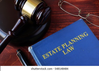 Book with title estate planning law and a gavel.