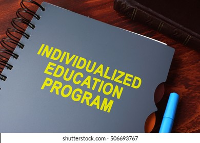 Book with title individualized education program (IEP) on a table.