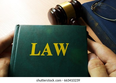 Book with title law and gavel. Litigation concept.