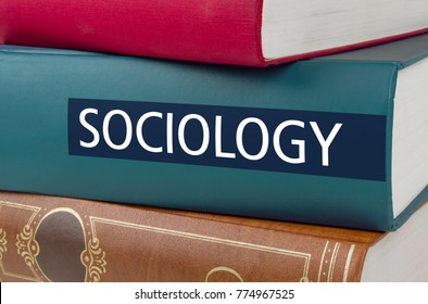 A book with the title Sociology written on the spine