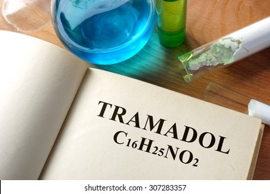 Book with tramadol and test tubes.