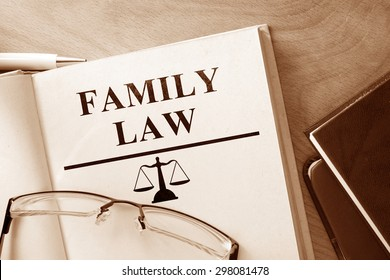 Book with words family law and glasses.