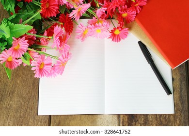 Book writing and pen for greeting or celebration.