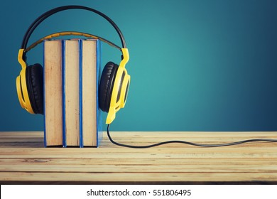 Book with Yellow headphones