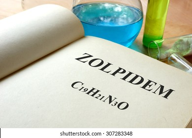 Book with Zolpidem  and test tubes.