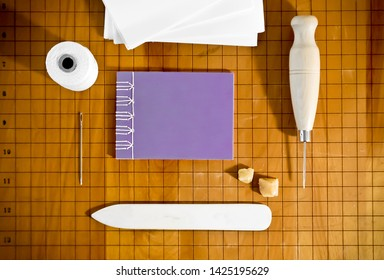 Bookbinding Materials with Small Purple Notebook