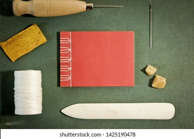 Bookbinding Tools with Hand Sewn Book Viewed from above