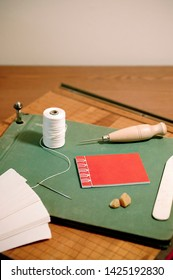 Bookbinding Tools on Wood Table or Desk