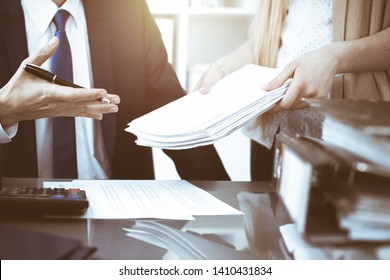 Bookkeeper or financial inspector hands making report, calculating or checking balance. Internal Revenue Service inspector man checking financial document. Business, tax and audit concepts