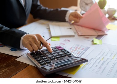 Bookkeeper or financial inspector hands making report, calculating. Home finances, investment, economy, saving money or insurance concept