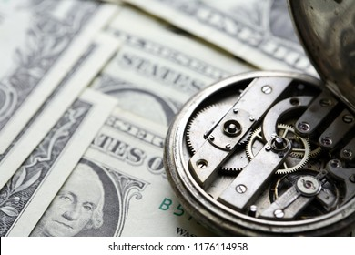 Bookkeeping concept. One dollar banknotes closeup as background and old watch