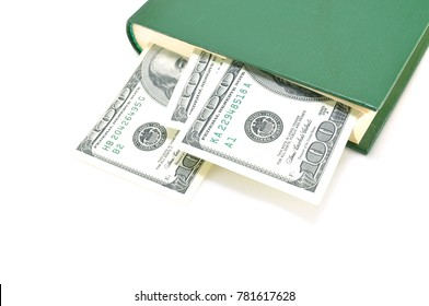 Bookmark in the form of a dollar on a white background close up