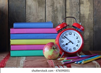 Books and an alarm clock. Back to school. September 1, knowledge Day. The teacher's day.