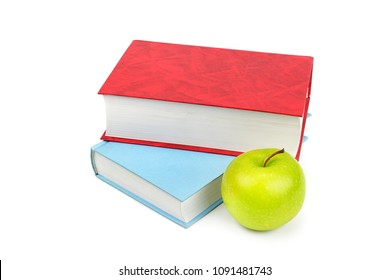Books and apple isolated on white background.